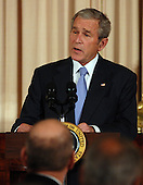 Washington, D.C. - November 26, 2007 -- United States President George W. Bush speaks before he offers a toast during a dinner at the State Department in Washington on the eve of a Middle East peace conference on November 26, 2007. Bush is hosting Palestinian President Mahmoud Abbas (not pictured) and Israeli Prime Minister Ehud Olmert (below). .Credit: Roger L. Wollenberg - Pool via CNP