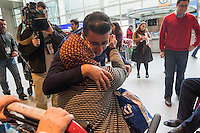 Amir Salehi, of Houston, Texas, embraces his mother Pouran Davari after she and his father arrived at Logan Airport's Terminal E in Boston, Massachusetts, USA. Salehi's parents flew from Tehran, Iran.