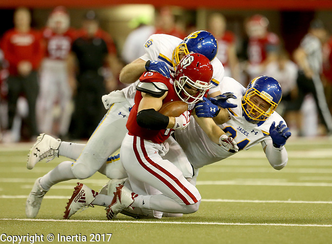 VERMILLION, SD - NOVEMBER 18: Ryan Earith #90 and Kellen Soulek #94 from South Dakota State University brings down Chris Streveler #15 from the University of South Dakota during their game Saturday afternoon at the DakotaDome in Vermillion. (Photo by Dave Eggen/Inertia)
