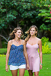 Two women in the garden, laughing in nature, Maui, Hawaii, USA
