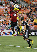 Bill Hamid #28 of D.C. United pulls in a high cross in front of Steven Lenhart #32 of the Columbus Crew during a US Open Cup semi final match at RFK Stadium on September 1 2010, in Washington DC. Columbus won 2-1 aet.