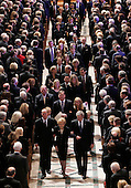 Washington, D.C. - January 2, 2007 -- Former first lady Betty Ford, center, escorted by United States President George W. Bush, right, and her son, Steve, left, leads the procession during a State Funeral service for her husband, former President Gerald R. Ford at the Washington National Cathedral in Washington, Tuesday, January 2, 2007.<br /> Credit: Pablo Martinez Monsivais-Pool via CNP