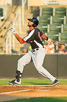 Nomar Mazara (12) of the Hickory Crawdads follows through on his swing against the Kannapolis Intimidators at CMC-Northeast Stadium on July 26, 2013 in Kannapolis, North Carolina.  The Intimidators defeated the Crawdads 2-1.  (Brian Westerholt/Four Seam Images)