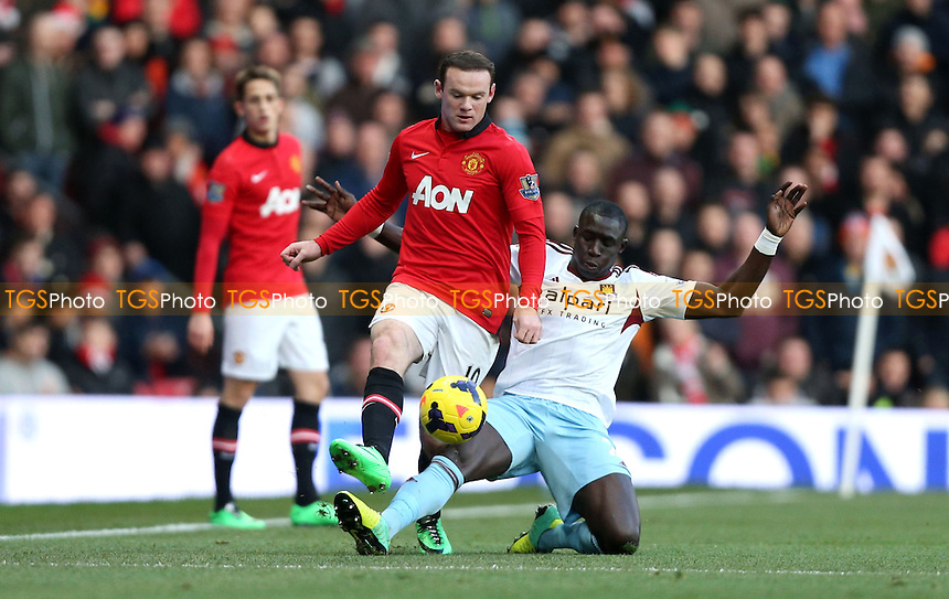 Wayne Rooney of Manchester United and Mohamed Diame of West Ham - Manchester United vs West Ham United, Barclays Premier League at Old Trafford, Manchester - 21/12/13 - MANDATORY CREDIT: Rob Newell/TGSPHOTO - Self billing applies where appropriate - 0845 094 6026 - contact@tgsphoto.co.uk - NO UNPAID USE