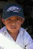 Nanacamilpa, Mexico. Portrait of a Mexican boy wearing an Eagles baseball cap.
