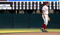 STANFORD, CA - May 10, 2011: Kenny Diekroeger of Stanford baseball stands in front of a scoreboard full of zeroes during Stanford's game against Arizona at Sunken Diamond. Stanford won 1-0.