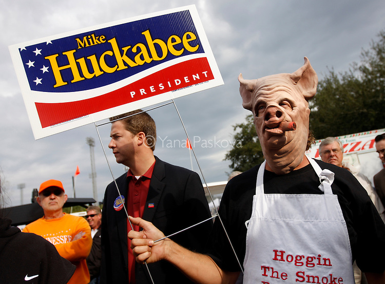 Ron Mattson, dresses as a pig to play the part in the Lakeland Pig Festival for pork tasting and judging as U.S. Presidential hopeful Mike Huckabee (R-AR) tours the festival in Lakeland, Florida, on Saturday, January 26, 2008. (Photo by: Yana Paskova for The New York Times)..Assignment ID: 30055282P..                                 ...........