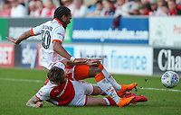 Rotherham United's Joe Mattock tackles Blackpool's Nathan Delfouneso<br /> <br /> Photographer Alex Dodd/CameraSport<br /> <br /> The EFL Sky Bet League One - Rotherham United v Blackpool - Saturday 5th May 2018 - New York Stadium - Rotherham<br /> <br /> World Copyright &copy; 2018 CameraSport. All rights reserved. 43 Linden Ave. Countesthorpe. Leicester. England. LE8 5PG - Tel: +44 (0) 116 277 4147 - admin@camerasport.com - www.camerasport.com