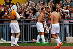 London, UK on Sunday 31st August, 2014. James Yammouni from the Janoskians (centre) celebrates a goal with fans during the Soccer Six charity celebrity football tournament at Mile End Stadium, London.