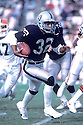 Los Angeles Raiders, Marcus Allen(32) in action against the Cleveland Browns on December  12, 1987 in Los Angeles at the Los Angeles Memorial Coliseum.  The Browns beat the Raiders 24-17.