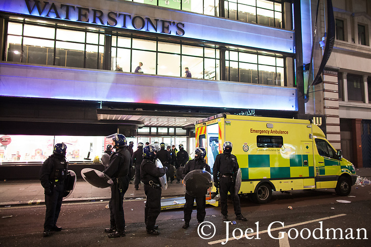 """© Joel Goodman - 07973 332324 . 26/03/2011 . London , UK . Riot police stand guard around and ambulance and paramedics , outside a branch of Waterstones . Hundreds of thousands of people attend an anti cuts demonstration under the banner """" March for the Alternative """" in central London , in protest at the coalition government's austerity measures . Photo credit : Joel Goodman"""