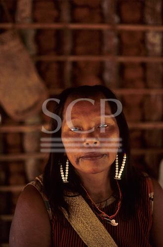 A-Ukre Village, Xingu, Brazil. Irepa, a Kayapo woman in her house wearing bead earrings.