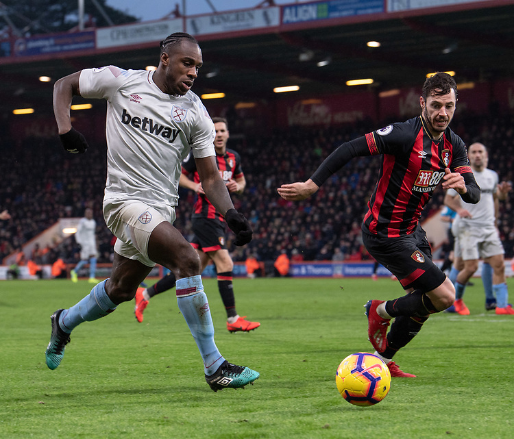 West Ham United's Michail Antonio (left) under pressure from Bournemouth's Adam Smith (right)  <br /> <br /> Photographer David Horton/CameraSport<br /> <br /> The Premier League - Bournemouth v West Ham United - Saturday 19 January 2019 - Vitality Stadium - Bournemouth<br /> <br /> World Copyright &copy; 2019 CameraSport. All rights reserved. 43 Linden Ave. Countesthorpe. Leicester. England. LE8 5PG - Tel: +44 (0) 116 277 4147 - admin@camerasport.com - www.camerasport.com