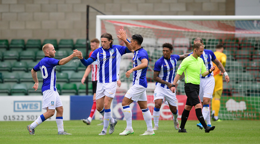 Sheffield Wednesday's Adam Reach, centre, celebrates scoring his side's second goal with team-mates Barry Bannan, left, and Joey Pelupessy<br /> <br /> Photographer Chris Vaughan/CameraSport<br /> <br /> Football Pre-Season Friendly - Lincoln City v Sheffield Wednesday - Saturday July 13th 2019 - Sincil Bank - Lincoln<br /> <br /> World Copyright © 2019 CameraSport. All rights reserved. 43 Linden Ave. Countesthorpe. Leicester. England. LE8 5PG - Tel: +44 (0) 116 277 4147 - admin@camerasport.com - www.camerasport.com