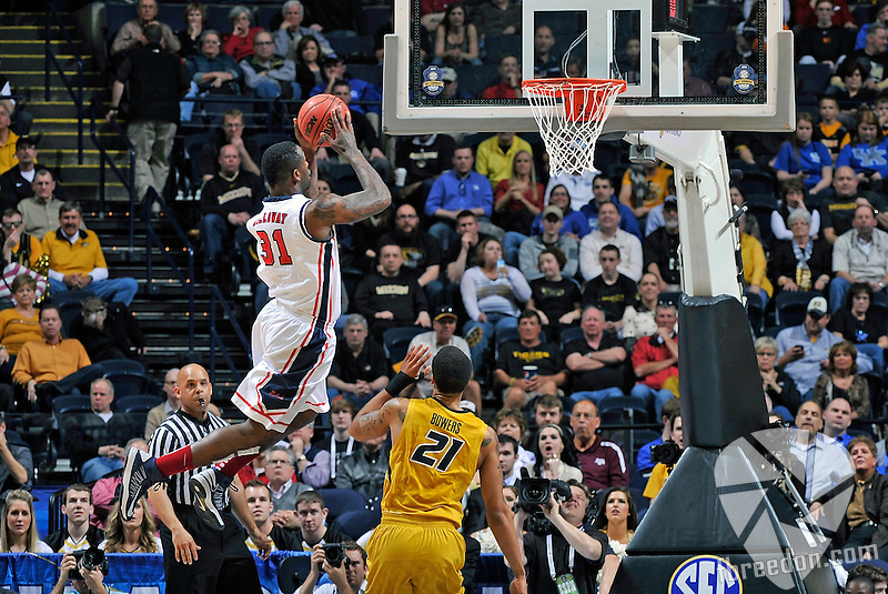 NASHVILLE, TN - MARCH 15:  Murphy Holloway #31 of the Ole Miss Rebels soars toward the basket against the Missouri Tigers during the Quarterfinals of the SEC Tournament at the Bridgestone Arena on March 15, 2013 in Nashville, Tennessee.  (Photo by Frederick Breedon/Getty Images)