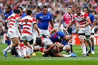 Samoa Outside Centre Paul Perez is tackled - Mandatory byline: Rogan Thomson - 03/10/2015 - RUGBY UNION - Stadium:mk - Milton Keynes, England - Samoa v Japan - Rugby World Cup 2015 Pool B.