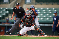 GCL Orioles catcher Stuart Levy (15) makes a play as umpire Ryan Baier looks on to make the call during the second game of a doubleheader against the GCL Rays on August 1, 2015 at the Ed Smith Stadium in Sarasota, Florida.  GCL Orioles defeated the GCL Rays 11-4.  (Mike Janes/Four Seam Images)