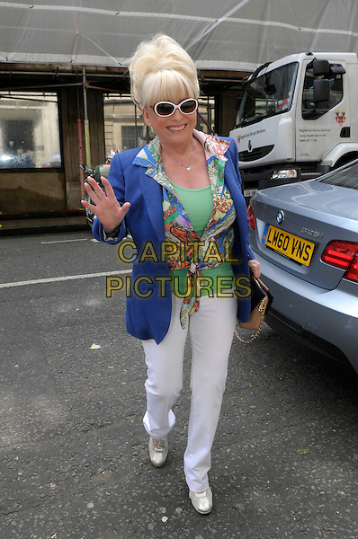 Barbara Windsor at BBC Radio 2, London, England..25th June 2012.full length babs white trousers blue blazer green top print knotted shirt sunglasses shades hand palm waving .CAP/IA.©Ian Allis/Capital Pictures.