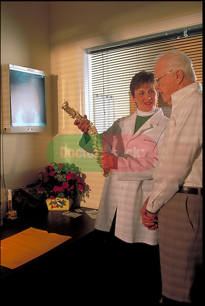 chiropractor discussing treatment with patient