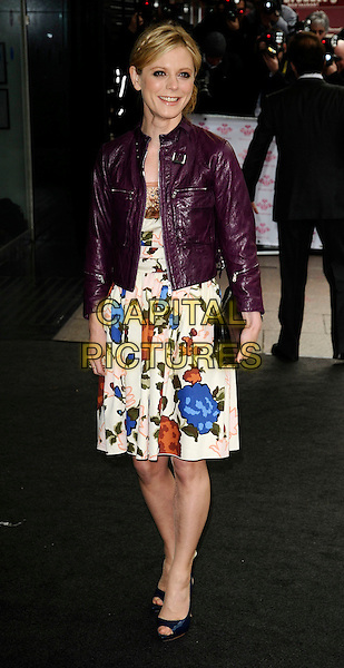 EMILIA FOX .At the Prince's Trust Celebrate Success Awards, Odeon cinema Leicester Square, London, England, UK,. March 31st 2009..full length purple leather jacket floral dress black clutch bag open toe shoes cropped .CAP/CAN.©Can Nguyen/Capital Pictures