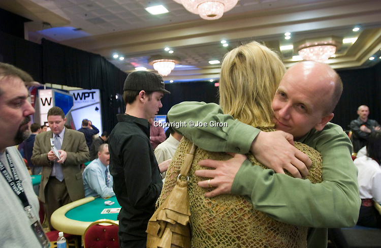 Steve Lipscomb gives Audrey Kania a hug.  Kania is an executive VP at the WPT.