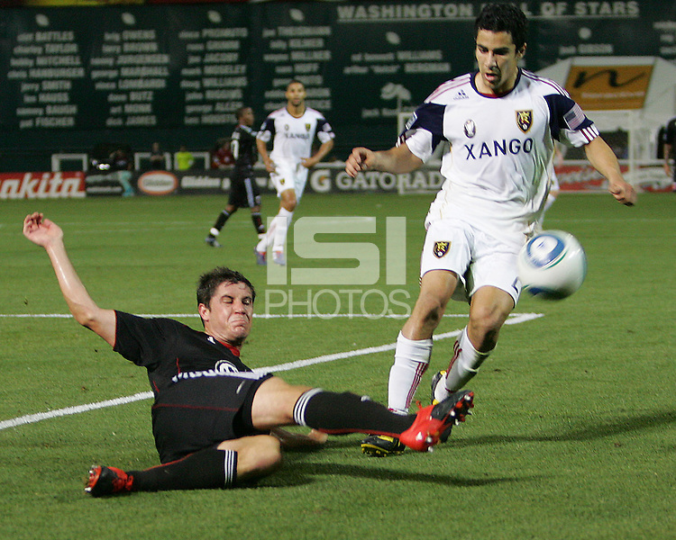Devon McTavish #18 of D.C. United  slides in to knock the ball away from Tony Beltran #2 of Real Salt Lake during an Open Cup match at RFK Stadium, on June 2 2010 in Washington DC. DC United won 2-1.