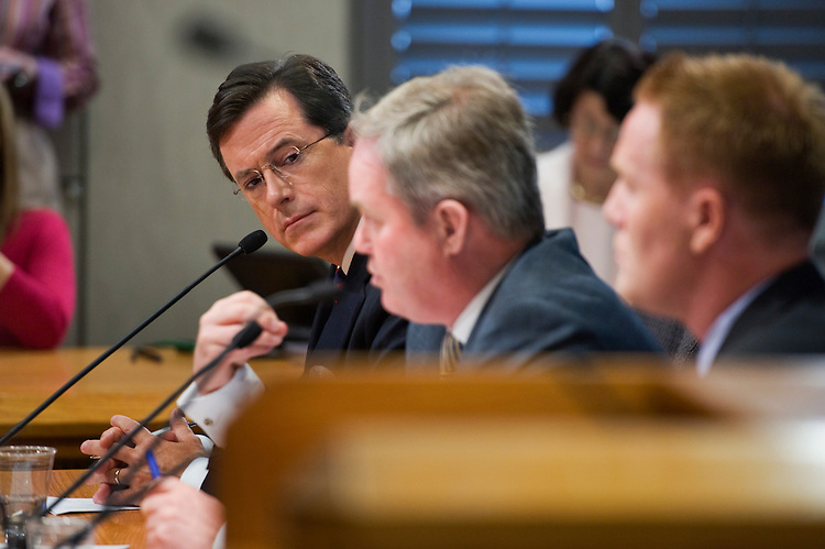 UNITED STATES - JUNE 30:  Stephen Colbert, left of Comedy Central, listens to his attorney Trevor Potter, center, during testimony at the Federal Election Commission (FEC) offices downtown where they appeared to request permission to set up a political action committee (PAC) called the Colbert Super PAC.  The request was subsequently approved by the commission. (Photo By Tom Williams/Roll Call)