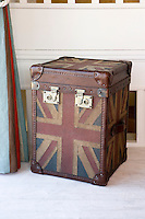 In the living room a leather trunk with a Union Jack motif also serves as an occasional table