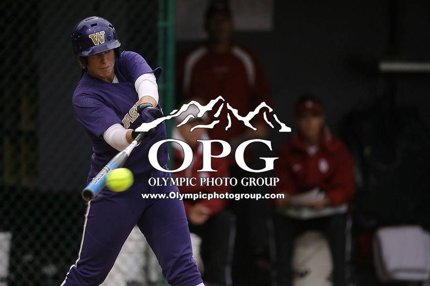 28 May 2010:  Washington Huskies Danielle Lawrie connects for a base hit against Oklahoma.  Washington defeated Oklahoma 3-0 in the second game of the NCAA Super Regional at Husky Softball Stadium in Seattle, WA.