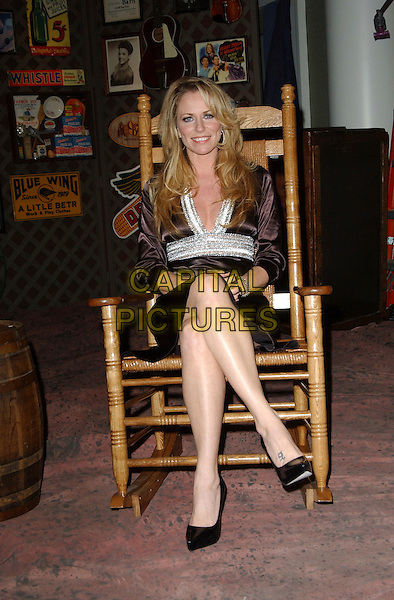 DEANA CARTER.Songs of the Year Taping Presented by Cracker Barrel held at Schermerhorn Symphony Center, Nashville, Tennessee, USA, 05 November 2006..full length sitting in chair.Ref: ADM/GS.www.capitalpictures.com.sales@capitalpictures.com.©George Shepherd/AdMedia/Capital Picture.