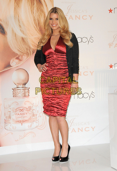 "JESSICA SIMPSON.launches ""Fancy"" her new fragrance at Macy's South Coast Plaza in Costa Mesa, California, USA, .December 13th 2008.                                                                    .full length red dress silk satin ruched  hand on hip cardigan  grey gray black peep toe patent shoes heels .CAP/DVS.©Debbie VanStory/Capital Pictures"