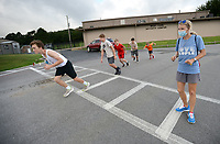 Tiffany Surber (right), West Fork cross country and track and field coach, gives instruction Friday, July 31, 2020, to her team during practice at West Fork Elementary School. The team ran relay drills while observing social-distancing requirements. Visit nwaonline.com/200801Daily/ for today's photo gallery.<br /> (NWA Democrat-Gazette/Andy Shupe)
