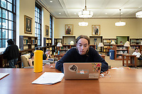 Ava Ciosek '21 writes an essay in the Ahmanson Reading Room<br /> Occidental College students study for finals and write papers during finals week in the Academic Commons/Mary Norton Clapp Library, Monday afternoon, Dec. 10, 2018.<br /> (Photo by Marc Campos, Occidental College Photographer)