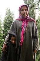 Portrait of young Bakarwal gypsy girl and boy, Western Himalayan Mountains, Kashmir, India..