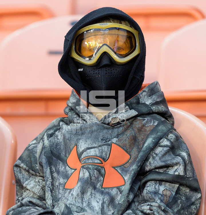 Houston, TX - Friday December 9, 2016: Cold fan trying to keep warm at the NCAA Men's Soccer Semifinals at BBVA Compass Stadium in Houston Texas.