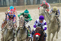 BALTIMORE, MD - MAY 21: Nyquist #3, ridden by Mario Gutierrez, (R) leads the field out of the fourth turn as Exaggerator #5, ridden by Kent J. Desormeaux, (C) gains ground during the 141st running of the Preakness Stakes at Pimlico Race Course on May 21, 2016 in Baltimore, Maryland. (Photo by Douglas DeFelice/Eclipse Sportswire/Getty Images)