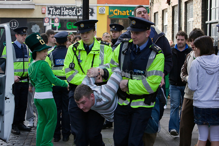 Gardai arresting youth, Temple Bar, Dublin, St. Patrick's Day, 2009