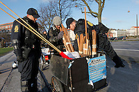 Police check people heading to large demonstration in the center of Copehagen. United Nations Climate Change Conference (COP15) was held at Bella Center in Copenhagen from the 7th to the 18th of December, 2009. A great deal of groups tried to voice their opinion and promote their cause in various ways. The conference and demonstrations was covered by thousands of photographers and journalists from all over the world...©Fredrik Naumann/Felix Features.
