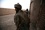 A Canadian soldier with the Royal 22nd Regiment watches for other enemy fighters after his platoon has just shot and killed three Taliban fighters in the village of Zalakhan in Kandahar province, Afghanistan. Aug. 8, 2009. DREW BROWN/STARS AND STRIPES
