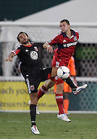 WASHINGTON, DC. - AUGUST 22, 2012:  Dwayne DeRosario (7) of DC United in action against  Austin Berry (22) of the Chicago Fire during an MLS match at RFK Stadium, in Washington DC,  on August 22. United won 4-2.