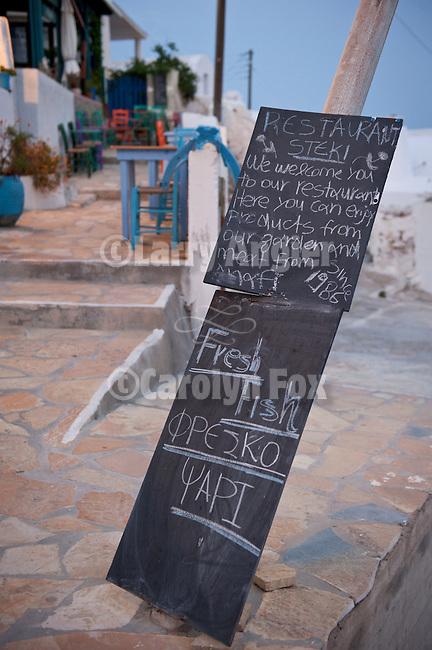 Menu board at a street side restaurant, Chora, Anafi, Greece