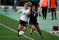 US's Sydney Leroux fights for the ball with Germany's Luisa Wensing during their Algarve Women's Cup soccer match at Algarve stadium in Faro, March 13, 2013.  .Paulo Cordeiro/ISI