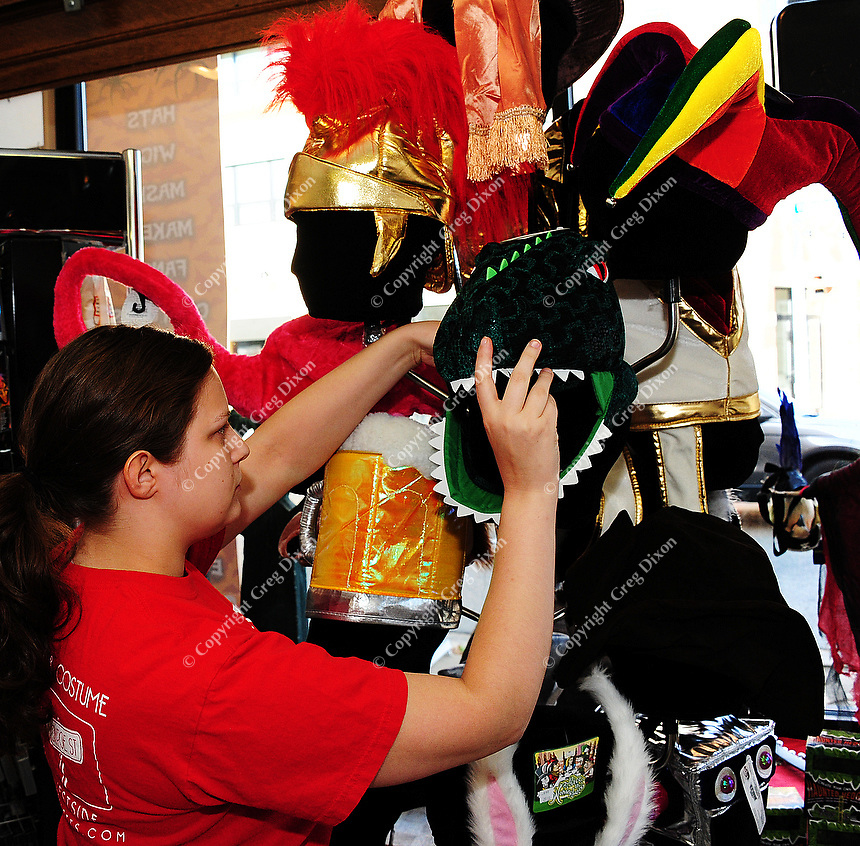 Lucy Jasper, of Mallatt Pharmacy and Costume, stocks costumes at the new Williamson Street location on Wednesday, October 13, 2010, in Madison, Wisconsin