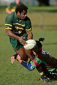 S. Lutumailagi gets his pass away as he is tackled by T. Kiel. Counties Manukau Premier Club Rugby, Pukekohe v Waiuku  played at the Colin Lawrie field, on the 3rd of 2006.Pukekohe won 36 - 14