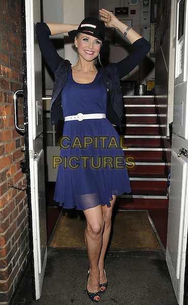 "Christie Brinkley .""Chicago"" musical cast departures, Cambridge Theatre,  London,  England, UK, 6th August 2011..full length navy blue dress hands arms raised up sheer belt hat peep toe shoes black cardigan .CAP/CAN.©Can Nguyen/Capital Pictures."