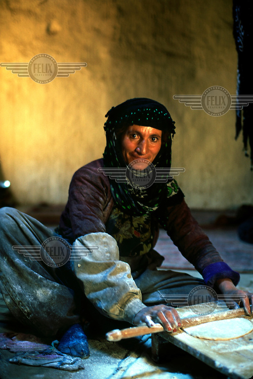 A Kurdish woman making bread in a village near Tak-i-Bustan (Tak-e-Bustan).