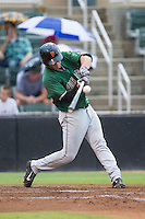Sam Mende (15) of the Augusta GreenJackets makes contact with the baseball during the game against the Kannapolis Intimidators at CMC-NorthEast Stadium on July 31, 2014 in Kannapolis, North Carolina.  The Intimidators defeated the GreenJackets 4-3.  (Brian Westerholt/Four Seam Images)