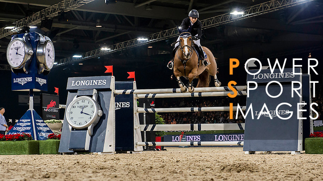 Jane Richard Philips of Switzerland rides Pablo de Virton in action during the Longines Grand Prix as part of the Longines Hong Kong Masters on 15 February 2015, at the Asia World Expo, outskirts Hong Kong, China. Photo by Victor Fraile / Power Sport Images