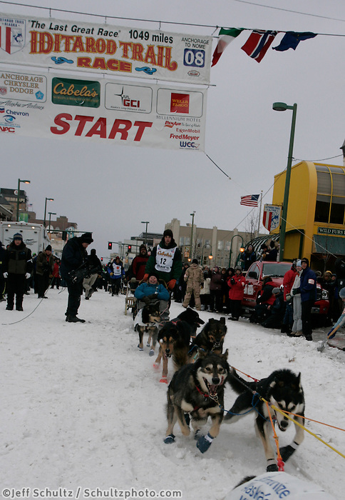 Joe Gans leaves the start line in Anchorage on Saturday March 1st during the ceremonial start day of the 2008 Iidtarod Sled Dog Race.