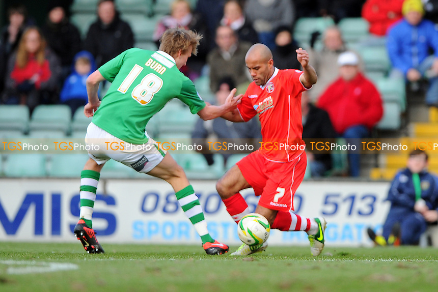 Dan Burn of Yeovil Town holds on to Adam Chambers of Walsall - Yeovil Town vs Walsall - NPower League One Football at Huish Park, Yeovil, Somerset - 29/03/13 - MANDATORY CREDIT: Denis Murphy/TGSPHOTO - Self billing applies where appropriate - 0845 094 6026 - contact@tgsphoto.co.uk - NO UNPAID USE.